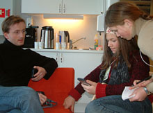 Geir, Camilla and Pernille are discussing use of handhelds